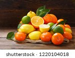 mix of fresh fruits with leaves ... | Shutterstock . vector #1220104018
