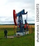 a blue with red oil rig pumps...   Shutterstock . vector #1220123572