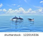 Three Dolphins Floating At...