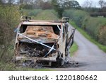 burnt out van abandoned in a...