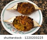 two stuffed crabs on plate. ... | Shutterstock . vector #1220203225