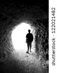 Man In A Cave. Light At End Of...