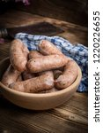 boiled white sausage in a... | Shutterstock . vector #1220226655