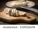 sliced tasty white sausage.... | Shutterstock . vector #1220226658