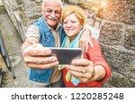 senior couple taking a selfie... | Shutterstock . vector #1220285248