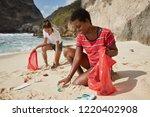 outdoor shot of volunteer girls ...   Shutterstock . vector #1220402908