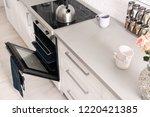 open modern oven built in... | Shutterstock . vector #1220421385