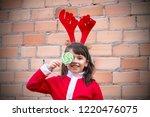 little pretty girl with... | Shutterstock . vector #1220476075