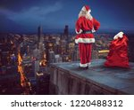 santa claus looks down on the... | Shutterstock . vector #1220488312