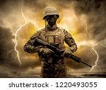 armed soldier standing in rainy ...   Shutterstock . vector #1220493055