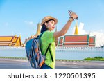 asian woman tourist travel... | Shutterstock . vector #1220501395