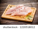 raw chicken breasts on cutting... | Shutterstock . vector #1220518012