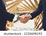 laconic image of two young men... | Shutterstock . vector #1220698192