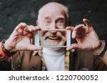 close up portrait of old joyful ... | Shutterstock . vector #1220700052