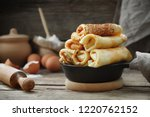 frying pan of freshly baked... | Shutterstock . vector #1220762152