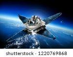 space satellite orbiting the... | Shutterstock . vector #1220769868