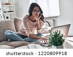 surfing the net. thoughtful... | Shutterstock . vector #1220809918