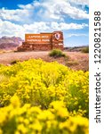 Beautiful view of Capitol Reef National Park entrance sign with blooming wildflowers in summer, central Utah, USA