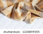 beige blanket on the new... | Shutterstock . vector #1220859355