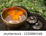 a copper singing bowl stands on ... | Shutterstock . vector #1220884168