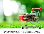 supermarket trolley with coins...   Shutterstock . vector #1220886982