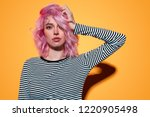 beautiful young lady in striped ... | Shutterstock . vector #1220905498