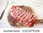 raw meat ribs on the cutting... | Shutterstock . vector #1221079228