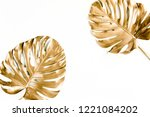 gold tropical palm leaves... | Shutterstock . vector #1221084202