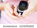 measurnig blood sugar level | Shutterstock . vector #1221092602