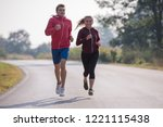 young couple enjoying in a... | Shutterstock . vector #1221115438