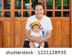 shot of mother while holding... | Shutterstock . vector #1221128935