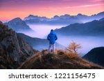 sporty man on the mountain peak ... | Shutterstock . vector #1221156475