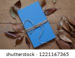 blue book and dry leaves on... | Shutterstock . vector #1221167365
