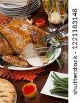 carving roasted pepper turkey... | Shutterstock . vector #1221183148