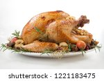 garnished roasted turkey with... | Shutterstock . vector #1221183475