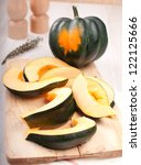 Small photo of Whole acorn squash and cut pieces vertical
