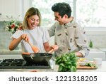 happy couple cooking in the... | Shutterstock . vector #1221318205