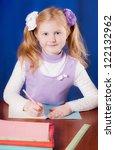 schoolgirl on the table | Shutterstock . vector #122132962