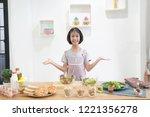 asian little girl cooks in the...   Shutterstock . vector #1221356278