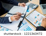 business team meeting present.... | Shutterstock . vector #1221363472