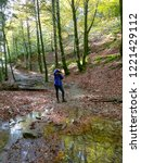 Stock photo woman taking photos in nature selva de irati navarra spain 1221429112
