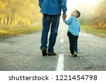 happy father and son walk in... | Shutterstock . vector #1221454798