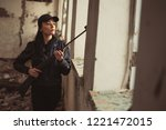 airsoft woman soldier with a... | Shutterstock . vector #1221472015