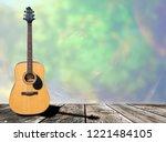 glistening wooden guitar on a... | Shutterstock . vector #1221484105