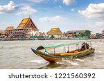 long tail boat in chao phraya... | Shutterstock . vector #1221560392