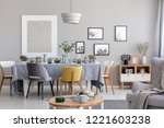 chairs at table with grey cloth ... | Shutterstock . vector #1221603238