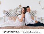man and pregnant woman sit side ... | Shutterstock . vector #1221606118