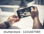 taking a photo of coffee with... | Shutterstock . vector #1221607585