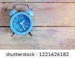 retro vintage alarm clock on... | Shutterstock . vector #1221626182