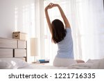 asian women she is in bed and... | Shutterstock . vector #1221716335